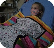 Kinsley in hospital bed