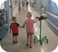 Kinsley walking with her brother