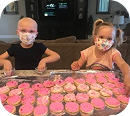 Kinsley and a little girl cooking cookies