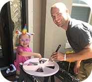 Kinsley and her dad painting