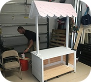 Kinsley's dad building the cooking cart