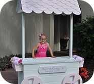 Kinsley behind the cookie cart