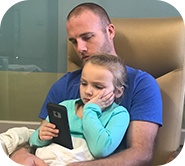 Kinsley sitting on her father