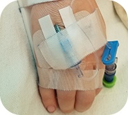 little hand with bandages and needles