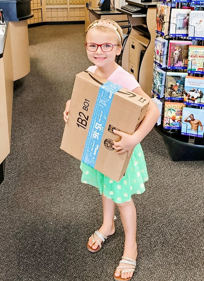 Kinsley with a box