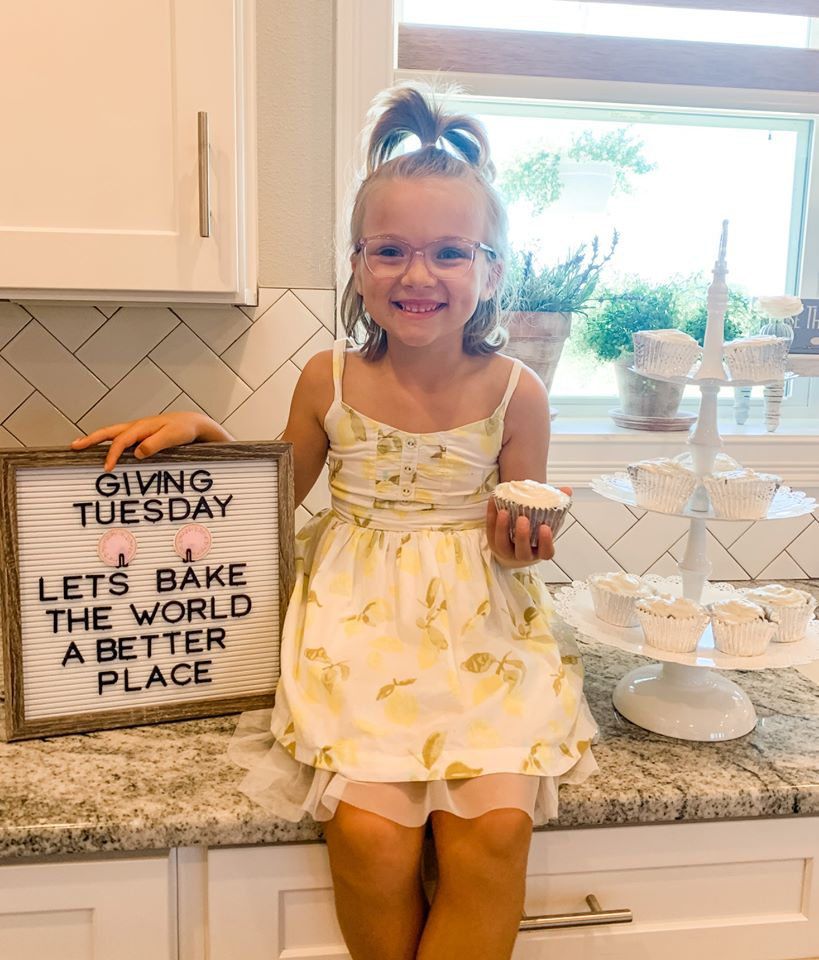 Kinsley on the kitchen holding a cookie