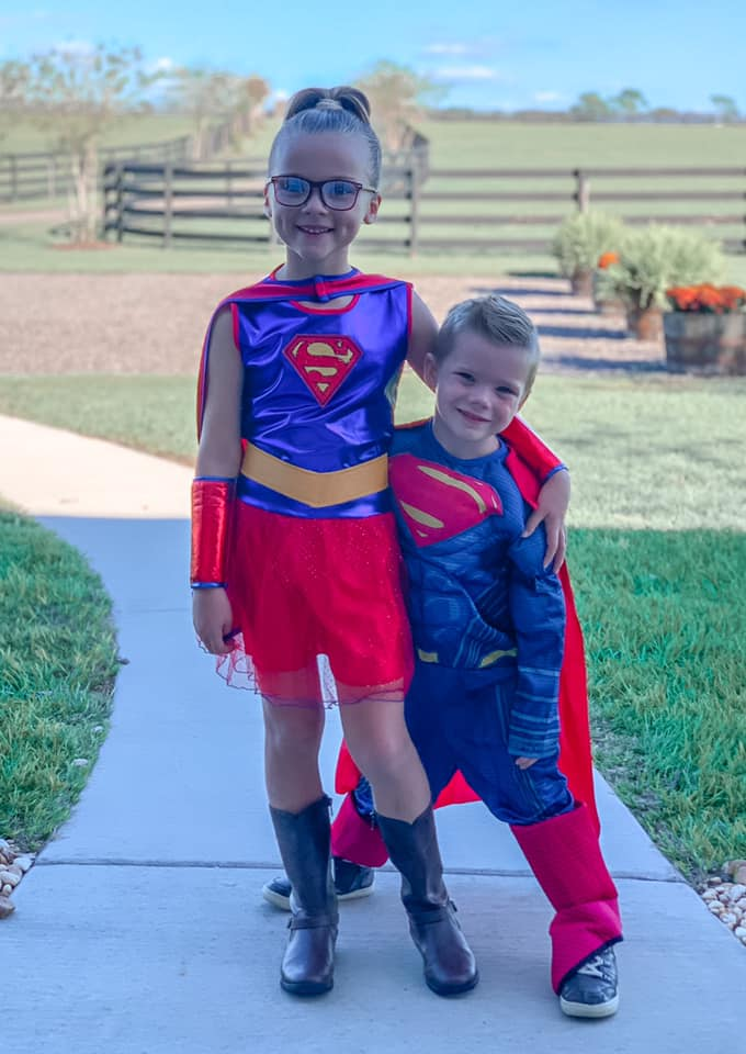 Kinsley and Reid dressed as super heroes