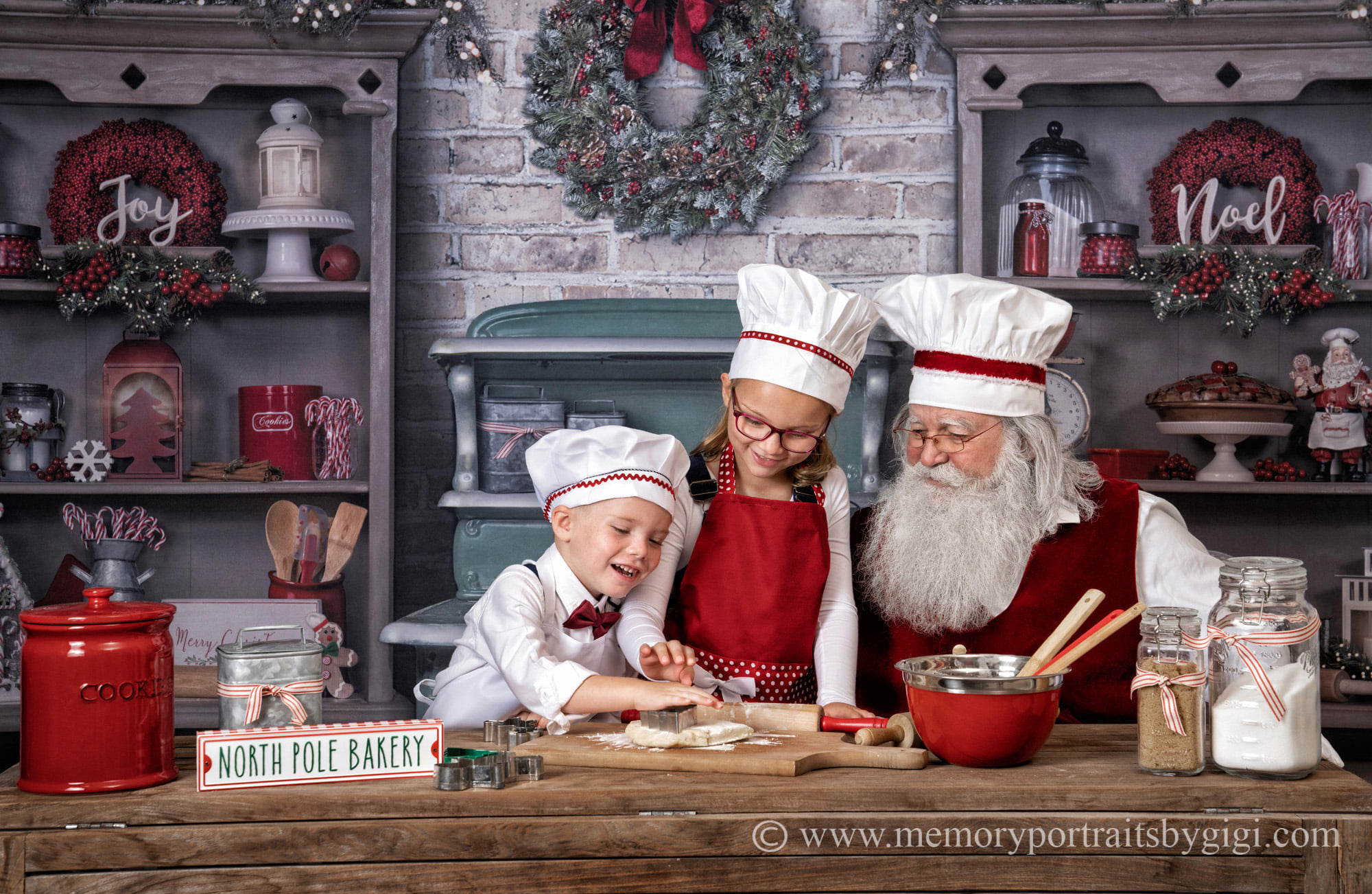 Reid and Kinsley cooking with Santa