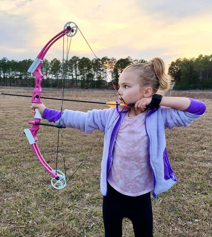 Kinsley shooting with a bow